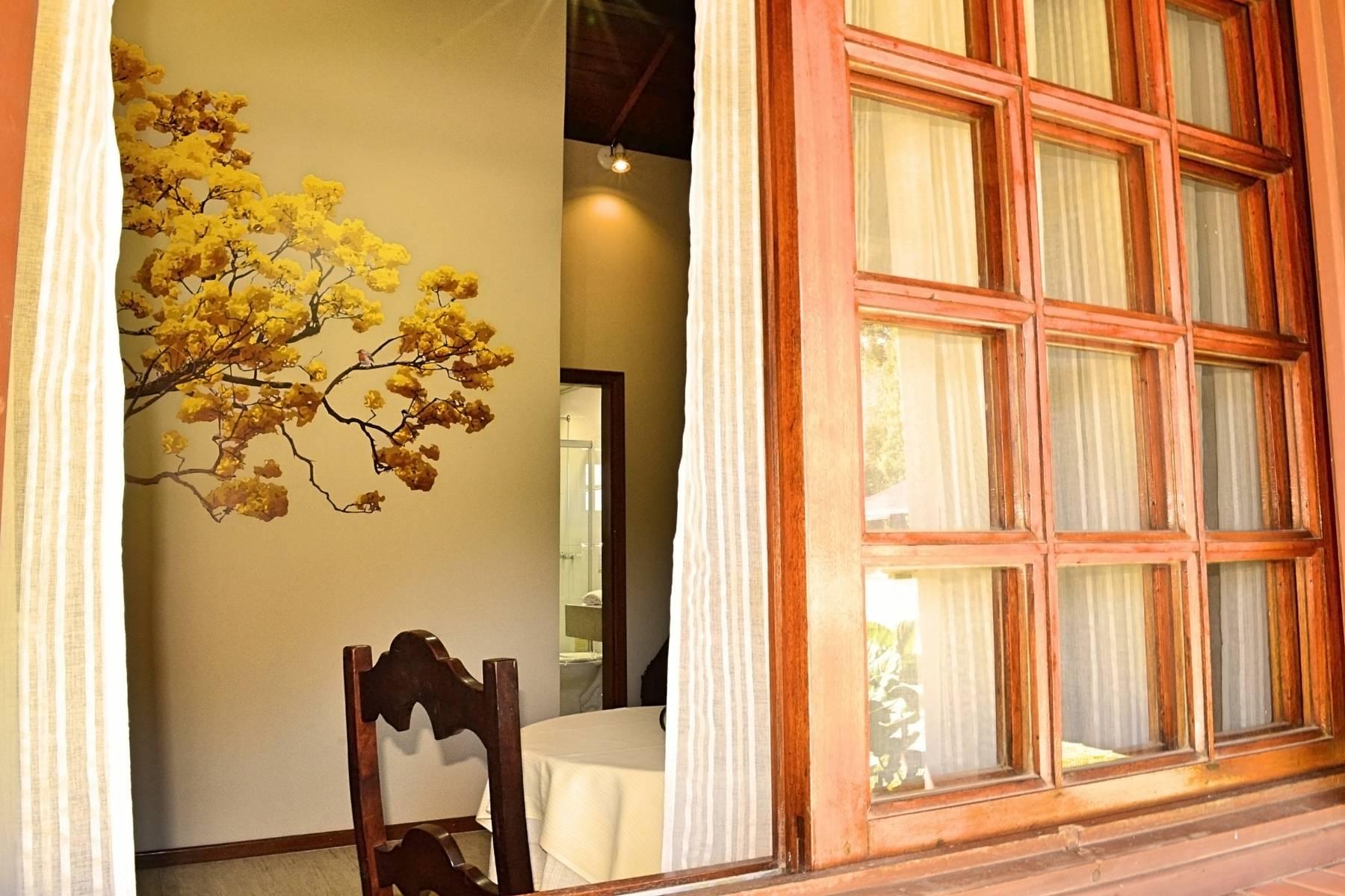 Bangalô Ipê - Acomodações do Hotel Bangalôs da Serra em Gramado #CurtaSuaFamilia #HotelSustentavel #TurismoVerde #TravelersChoice #EcoLider #Gramado #SerraGaucha